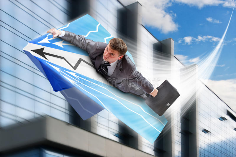 Businessman flying on airpaper plane stock images