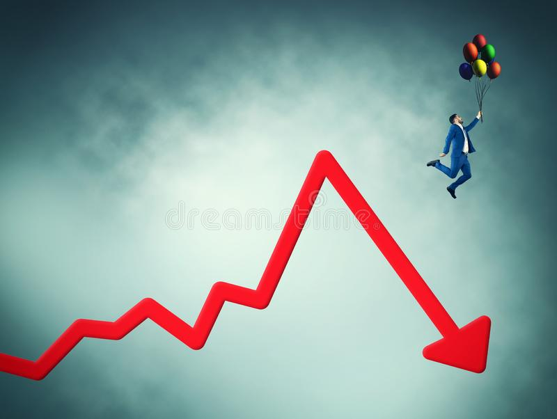 Decreased graph. image of concept. Businessman flying with balloons off a decreasing graph stock photos