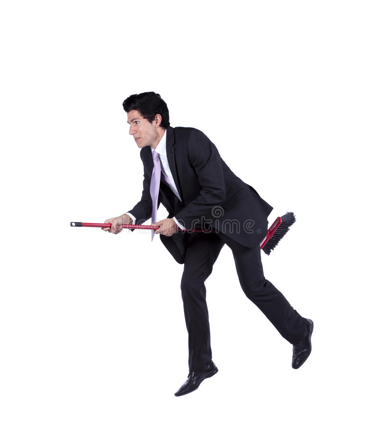 Businessman flying a broom royalty free stock images