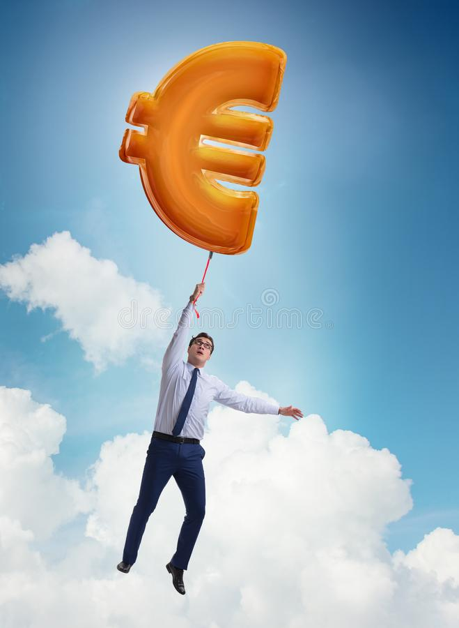 Businessman flying on euro sign inflatable balloon stock images