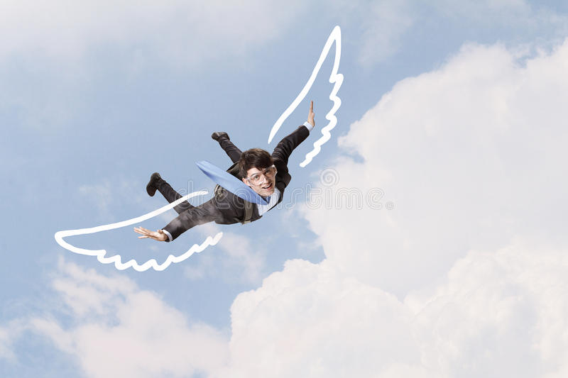 Businessman flying high stock photography
