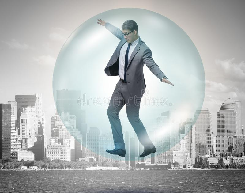 Businessman flying inside the bubble. The businessman flying inside the bubble stock images