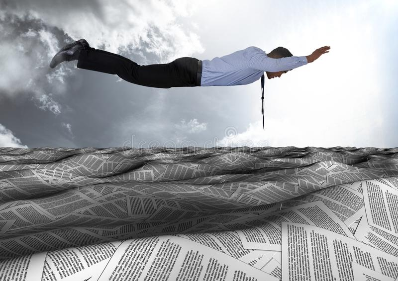 Businessman flying over sea of documents under sky clouds stock photos