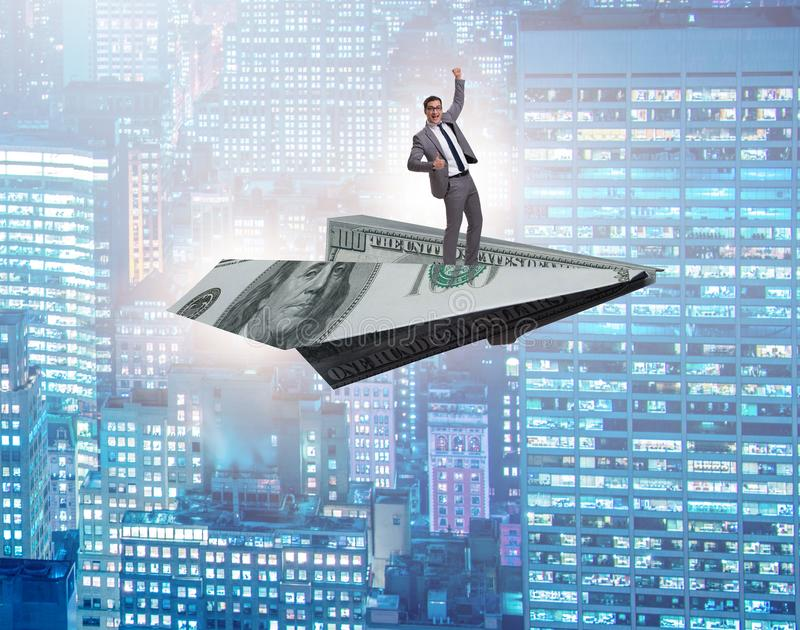 Businessman flying on paper plane in business concept. The businessman flying on paper plane in business concept royalty free stock images