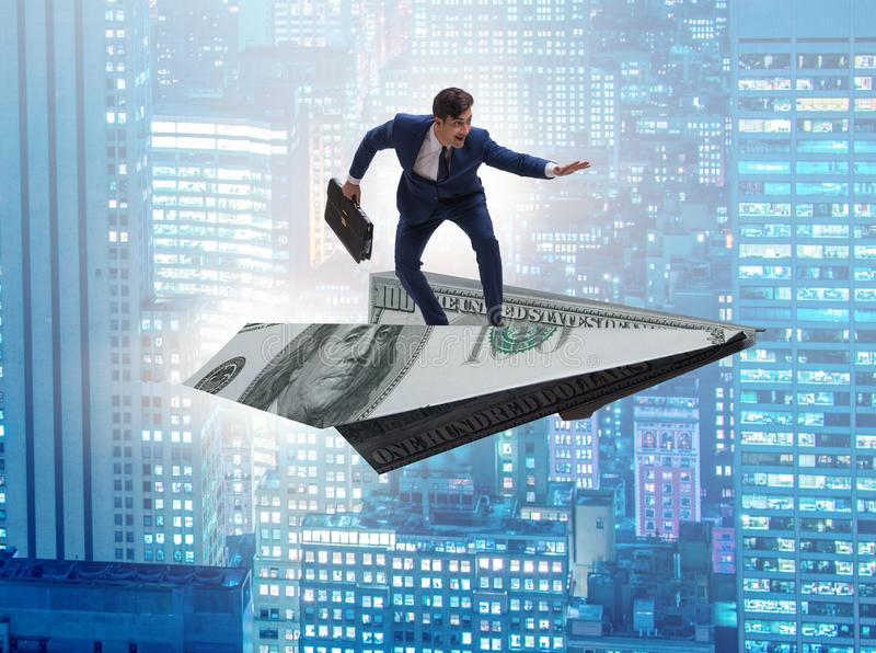 Businessman flying on paper plane in business concept. The businessman flying on paper plane in business concept stock images