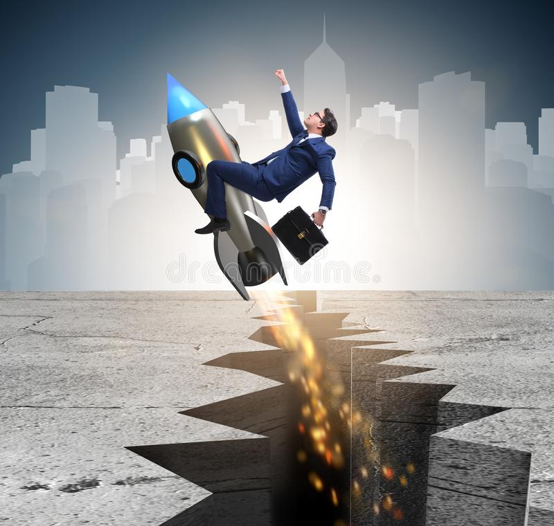 Businessman flying on rocket from rock gap. The businessman flying on rocket from rock gap royalty free stock photos