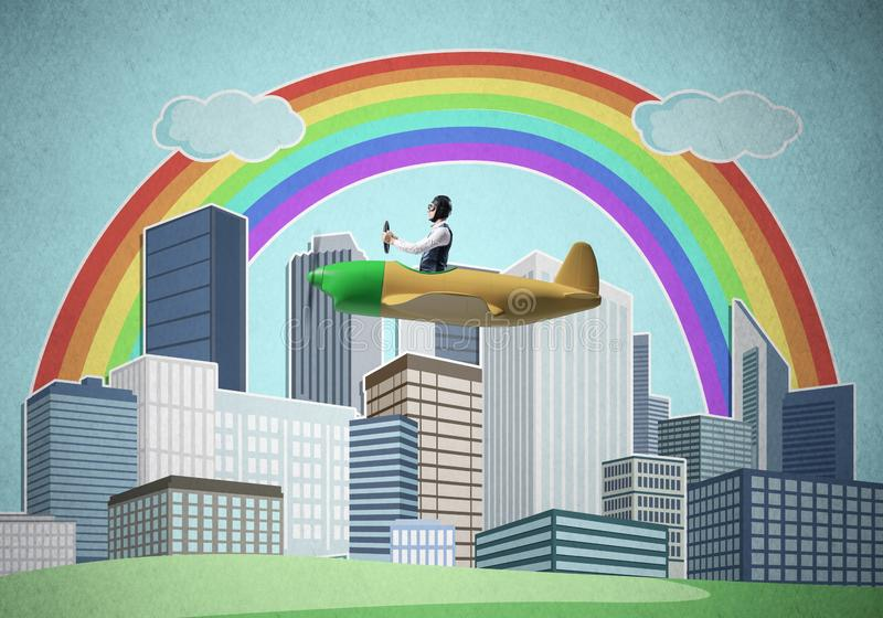 Businessman flying in small propeller plane. Above metropolis. Aviator driving retro airplane on background of city. Cityscape with high skyscrapers and stock photos