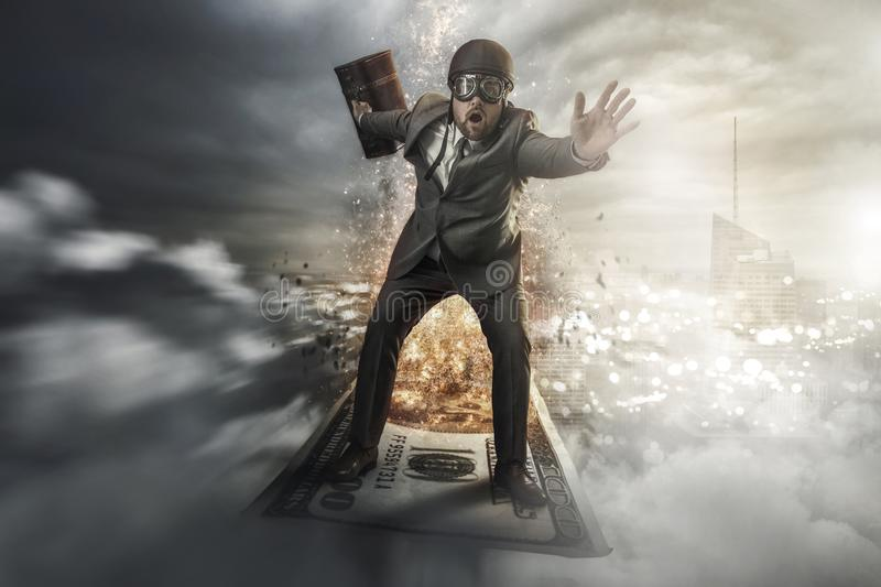 Businessman flying on top of money royalty free stock image