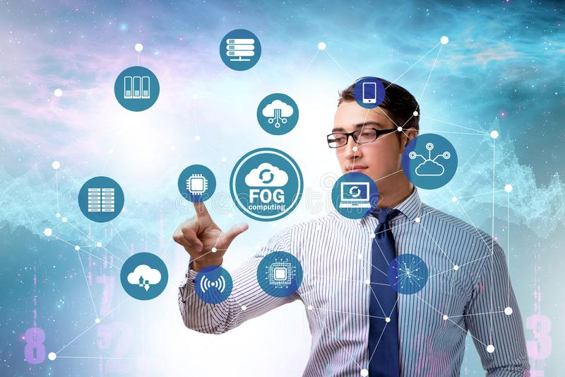 Businessman in fog and edge cloud computing concept. The businessman in fog and edge cloud computing concept stock photography