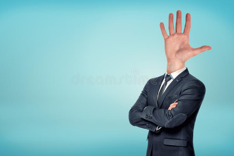 A businessman with folded arms has a large wide opened hand and fingers sticking out. Business and networking. Natural friendliness. Networking approaches stock photo