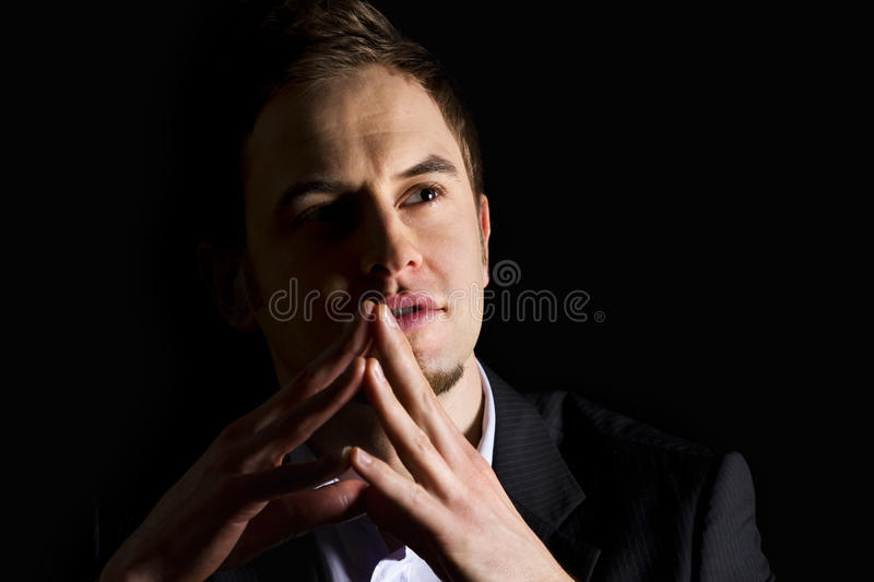 Download Businessman With Folded Hands Looking Up. Royalty Free Stock Images - Image: 18675209