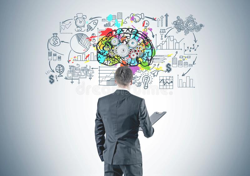 Businessman with folder, business mind, cog brain stock photography