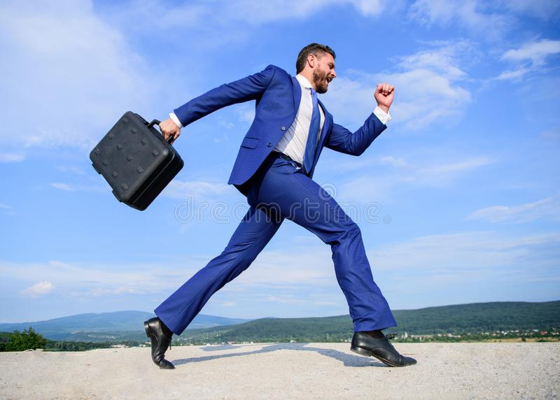Businessman formal suit carries briefcase sky background. Businessman hurrying to business meeting. I will be there in royalty free stock images