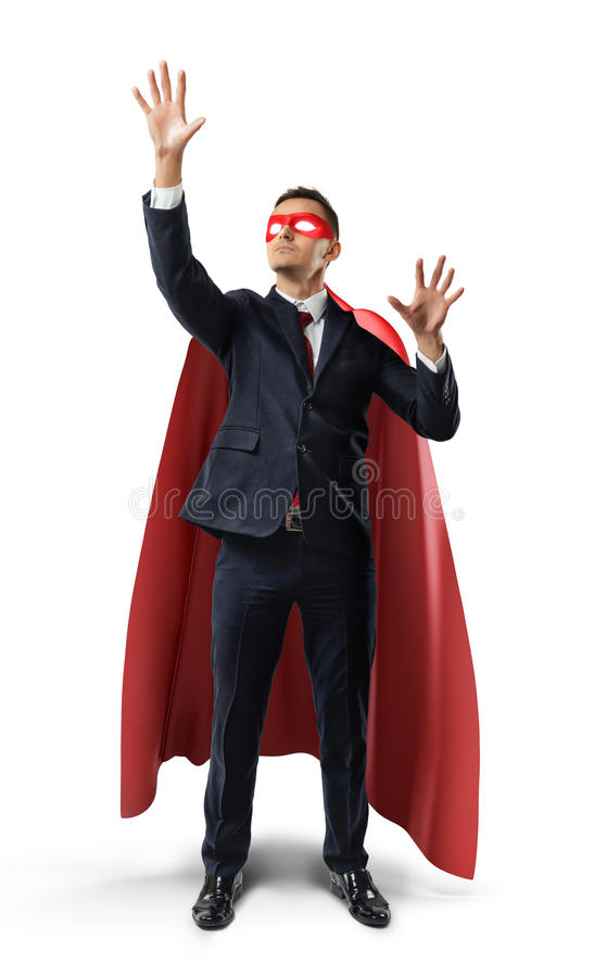 A businessman in a formal suit and superhero cape manipulating invisible digital screen objects. stock photos