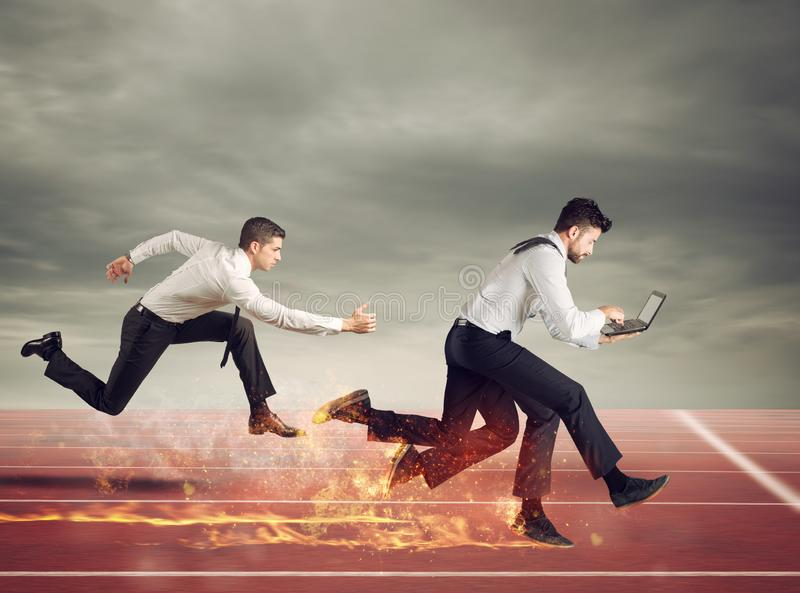 Businessman with four legs runs with too many tasks on laptop. Concept of competition and success royalty free stock images