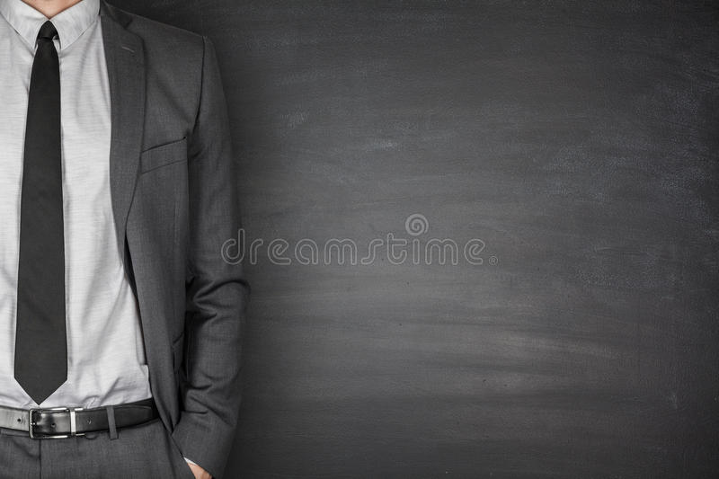Businessman Front of Blackboard royalty free stock image
