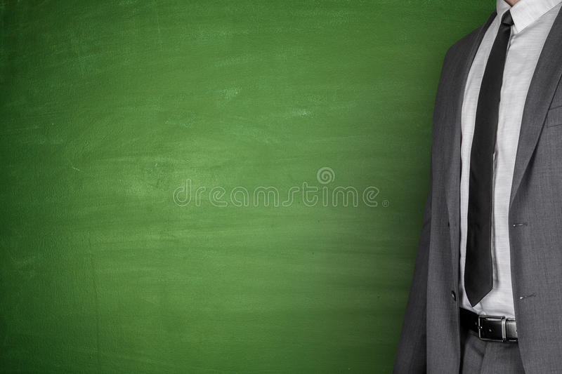 Businessman front of Blackboard stock photos