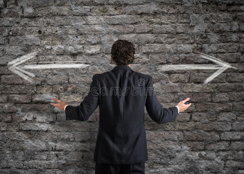 Businessman in front of a choice royalty free stock photography