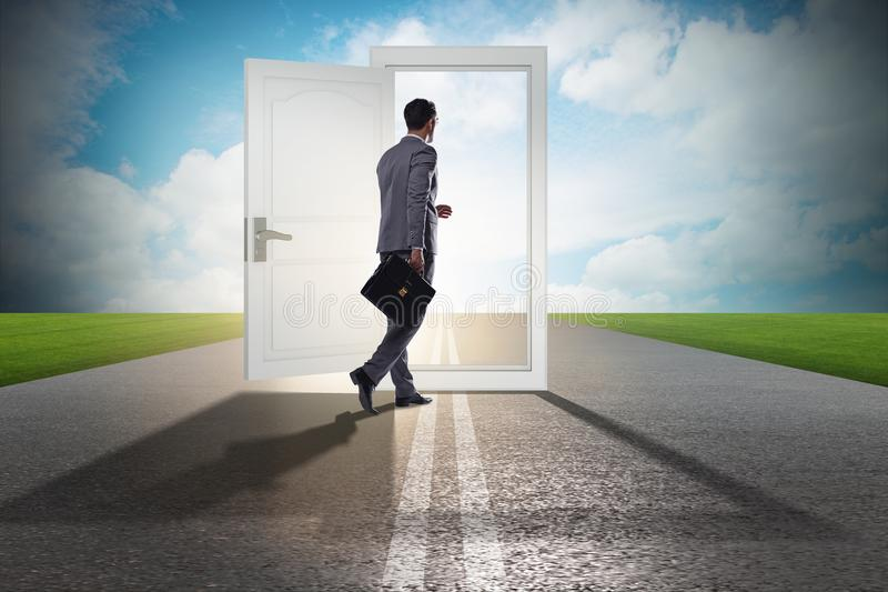 The businessman in front of door in business opportunities concept royalty free stock image