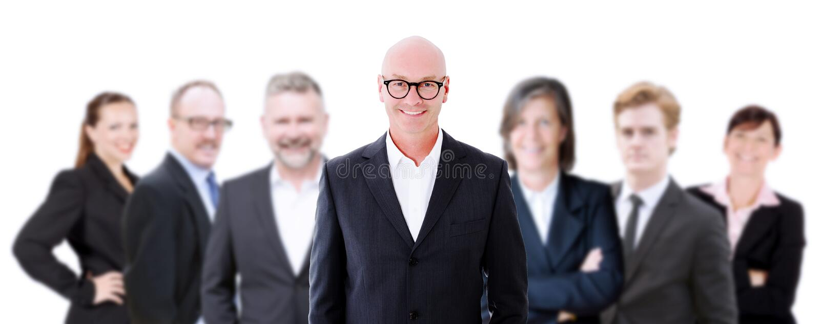 Businessman in front of his team stock photos