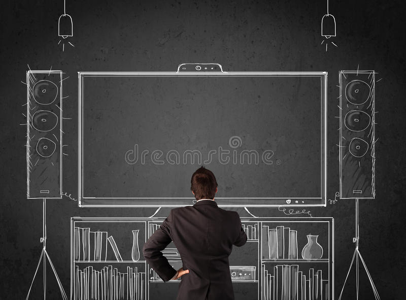 Download Businessman In Front Of A Home Cinema System Stock Photo - Image: 37795376
