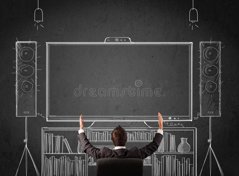 Download Businessman In Front Of A Home Cinema System Stock Photo - Image of formal, chair: 36570876