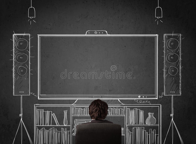 Download Businessman In Front Of A Home Cinema System Stock Photo - Image: 40052240