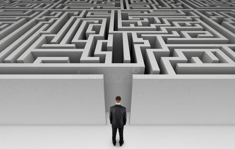 Businessman in front of a huge maze. Business problem