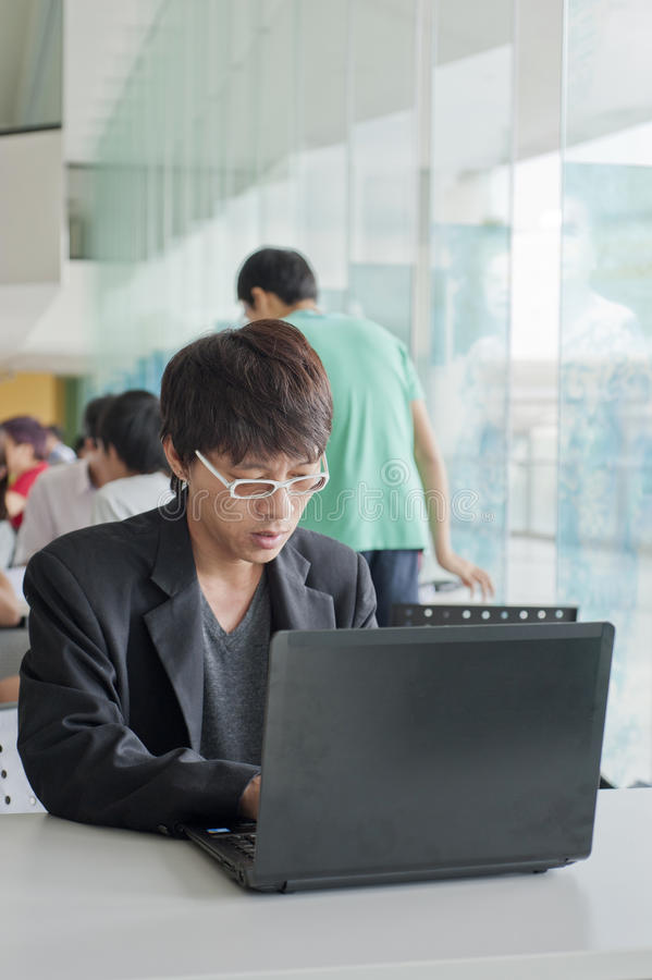 Businessman in front of laptop royalty free stock photo