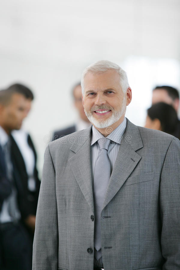 Businessman in front of sales team royalty free stock photo