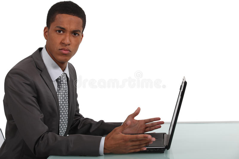 Businessman frustrated by laptop royalty free stock image