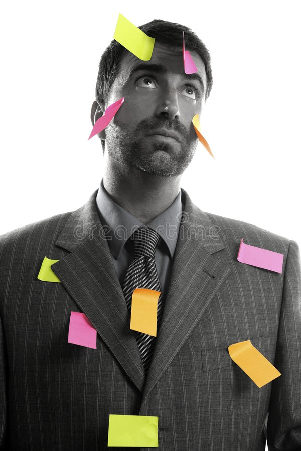 Businessman full of memo stock message notes royalty free stock images