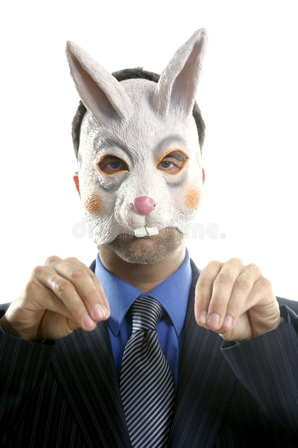 Businessman with funny rabbit mask stock images