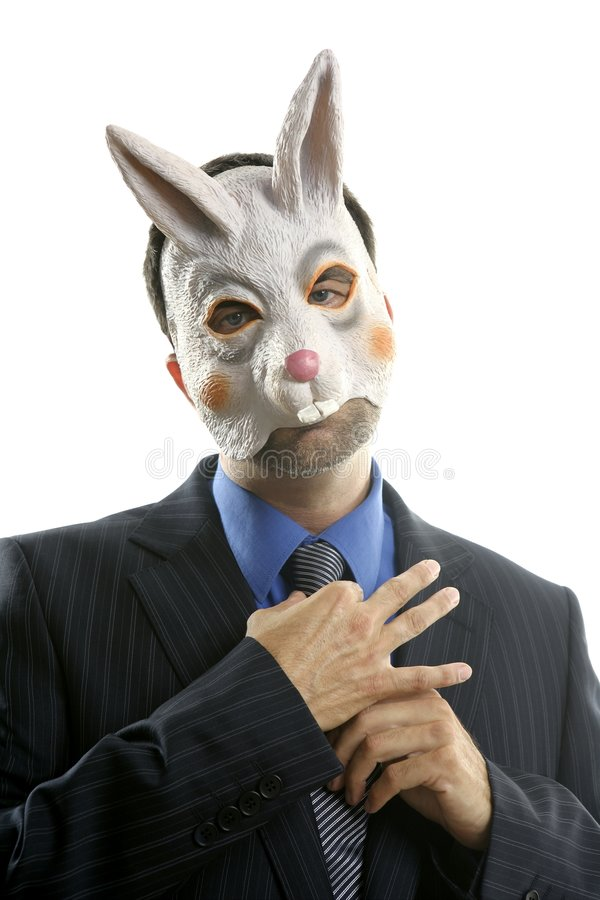 Businessman with funny rabbit mask royalty free stock image