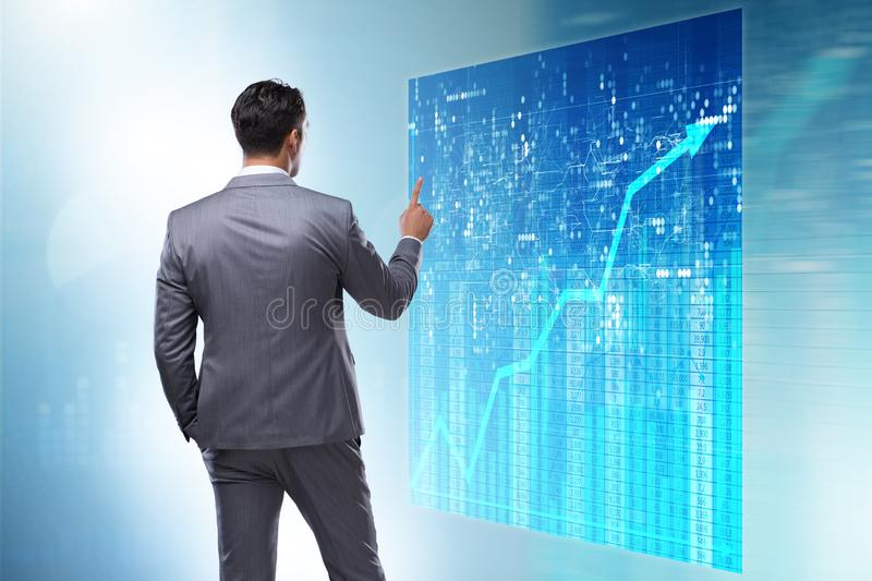 The businessman in futuristic stock trading concept. Businessman in futuristic stock trading concept royalty free stock images