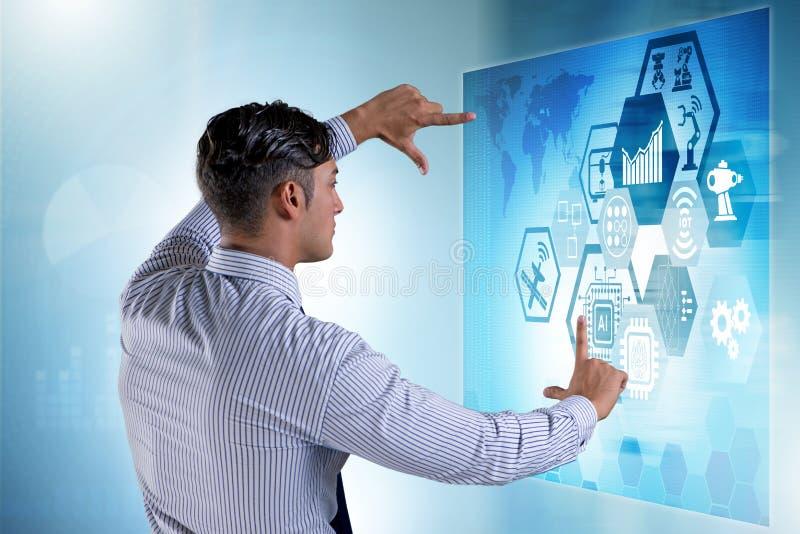 The businessman in futuristic stock trading concept. Businessman in futuristic stock trading concept stock photo