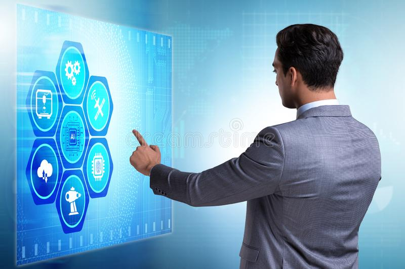 The businessman in futuristic stock trading concept. Businessman in futuristic stock trading concept stock photography
