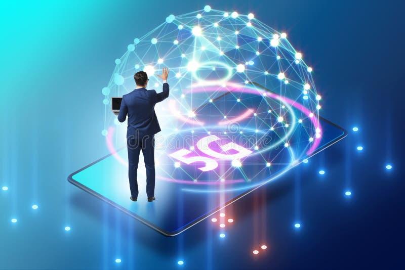 Businessman in 5g high internet speed concept. The businessman in 5g high internet speed concept stock image