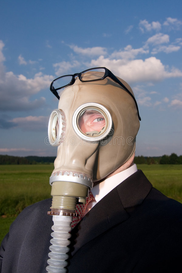 Businessman in gas mask stock image