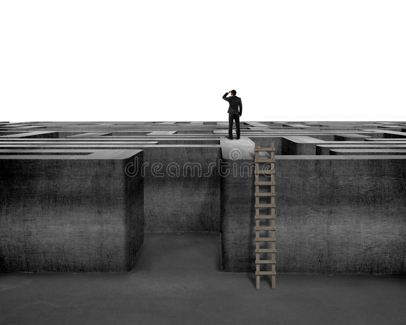 Businessman gazing on top of 3D concrete maze structure. Isolated in white background royalty free stock image