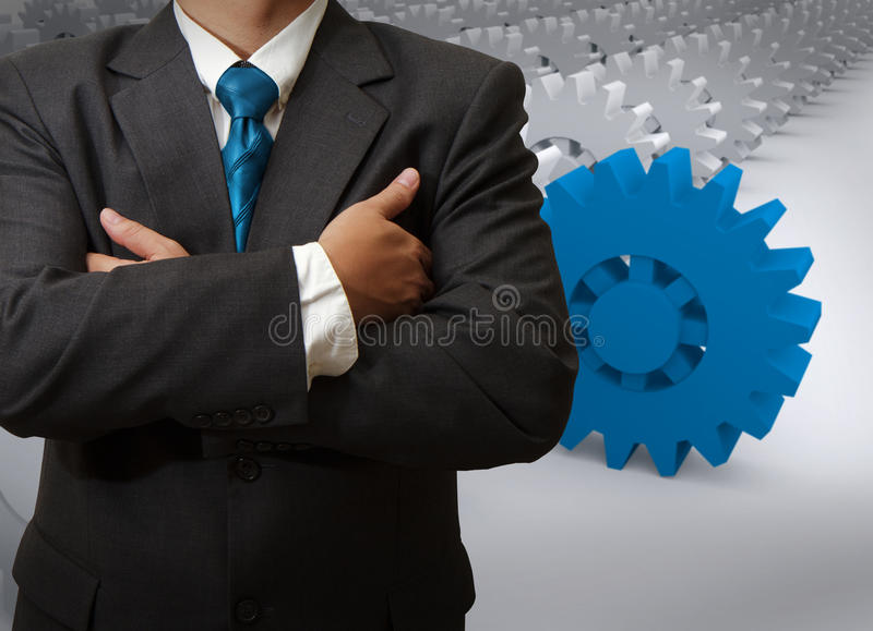 Businessman And Gear To Success Stock Photo
