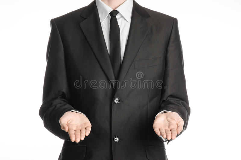 Businessman and gesture topic: a man in a black suit and tie holding two hands in front isolated on white background in studio stock photos