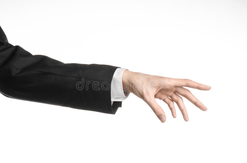 Businessman and gesture topic: a man in a black suit and white shirt showing hand gesture on an isolated white background in royalty free stock images