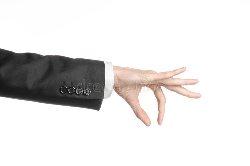 Businessman and gesture topic: a man in a black suit and white shirt showing hand gesture on an isolated white background in royalty free stock photography