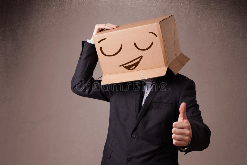 Download Businessman Gesturing With A Cardboard Box On His Head With Smil Stock Photo - Image of emoticon, card: 30744126