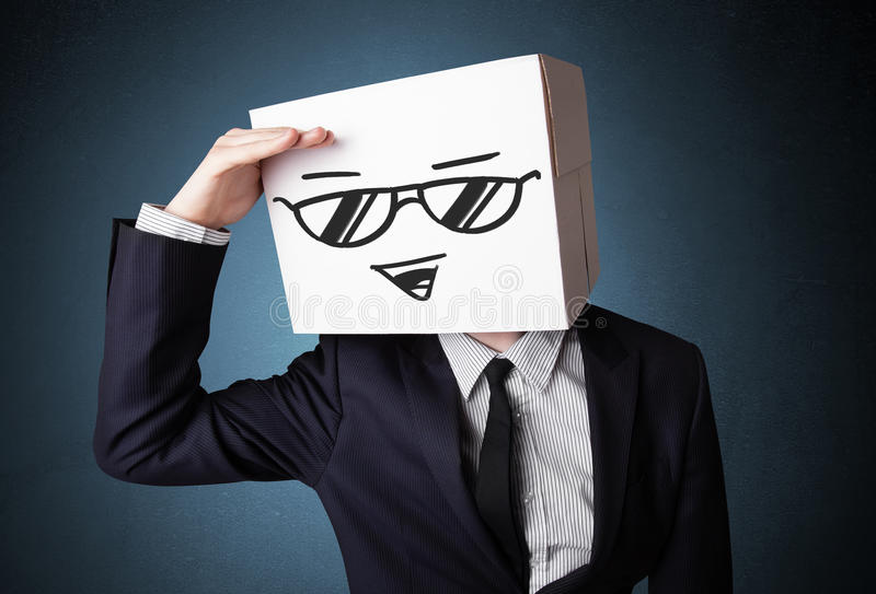 Download Businessman Gesturing With A Cardboard Box On His Head With Smil Stock Photo - Image: 32565204
