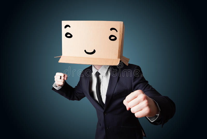 Download Businessman Gesturing With A Cardboard Box On His Head With Smil Royalty Free Stock Photo - Image: 34999095