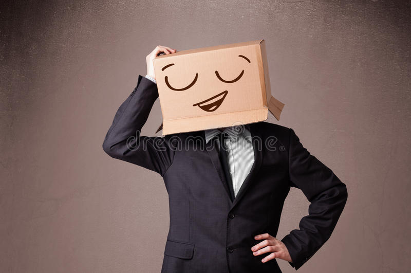 Download Businessman Gesturing With A Cardboard Box On His Head With Smil Stock Image - Image: 35938239