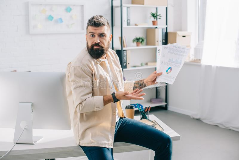 Businessman gesturing and looking surprised royalty free stock photos