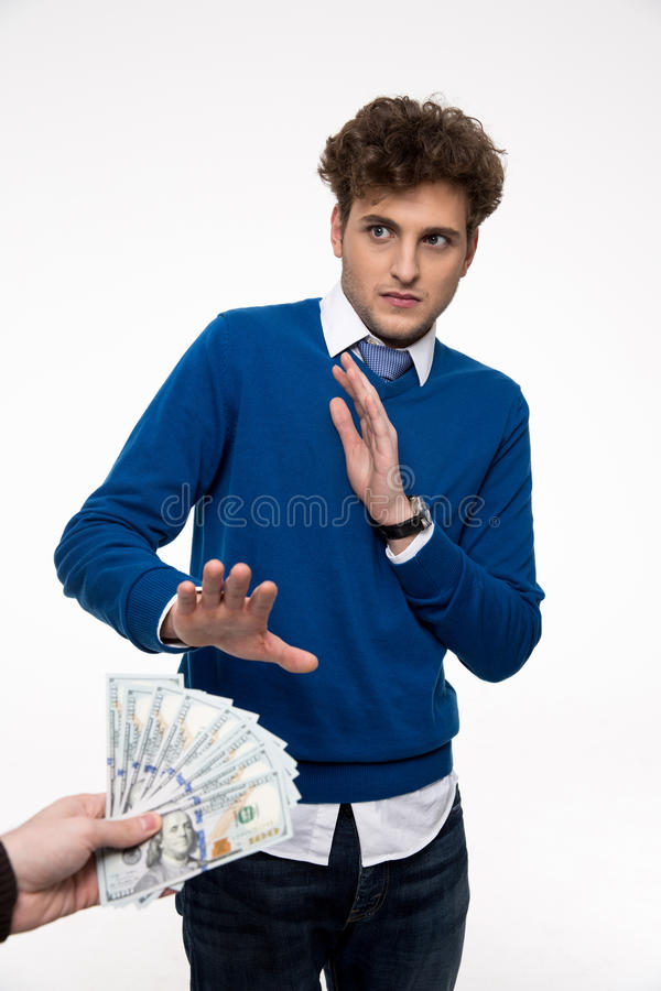 Businessman gesturing stop sign. While someone proposing money to him royalty free stock images
